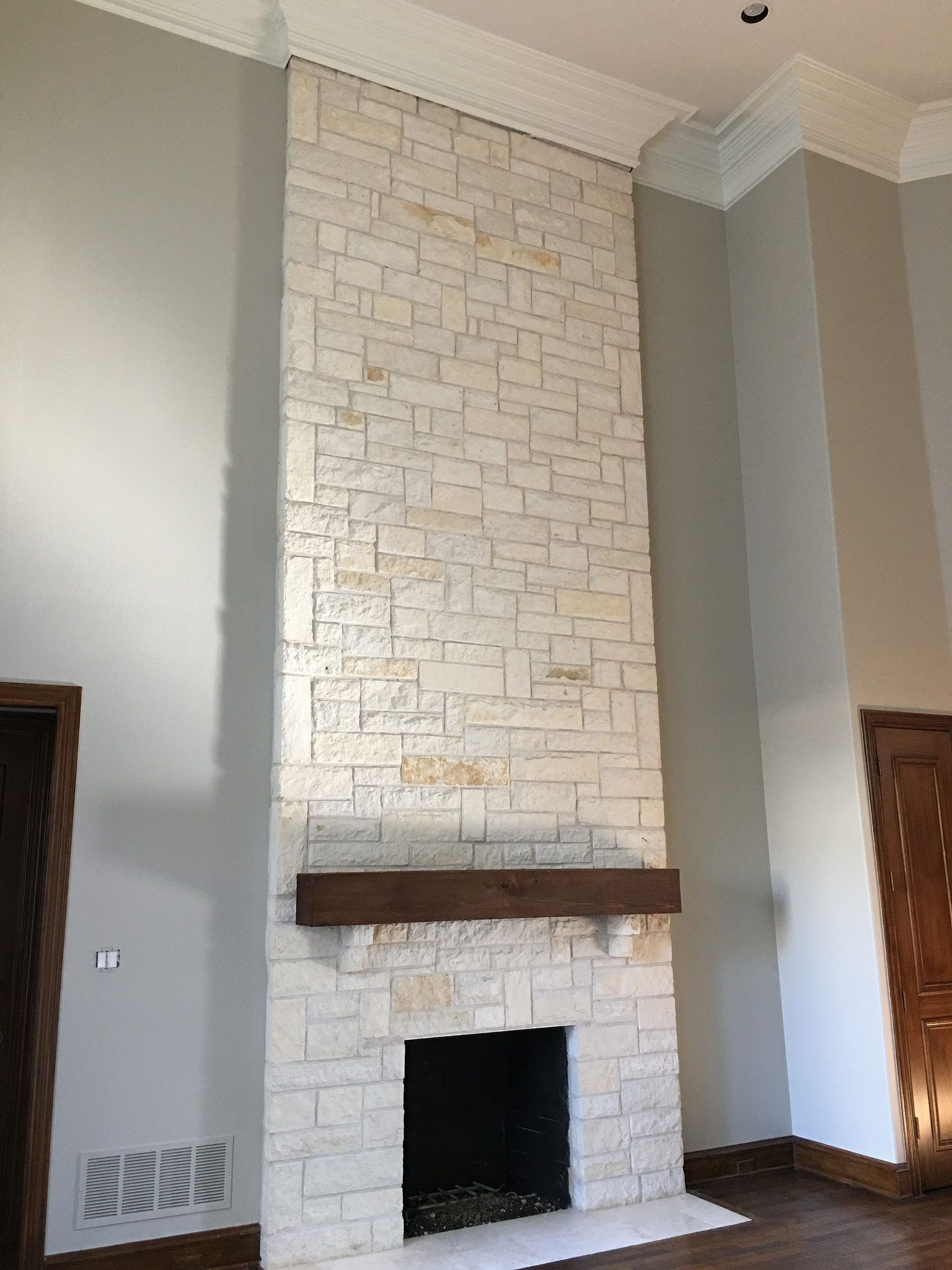 white austin stone fireplace after photo with revere pewter