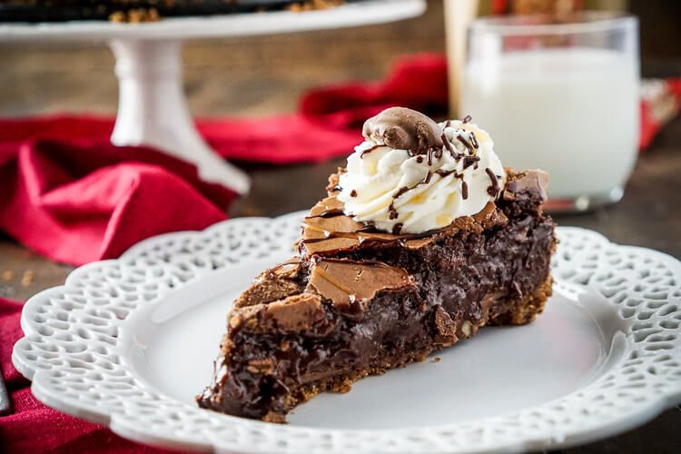 This Gooey Turtle Brownie Pie is the ultimate comfort dessert! A brownie baked into a graham cracker crust and laced with TURTLES clusters and pecans!