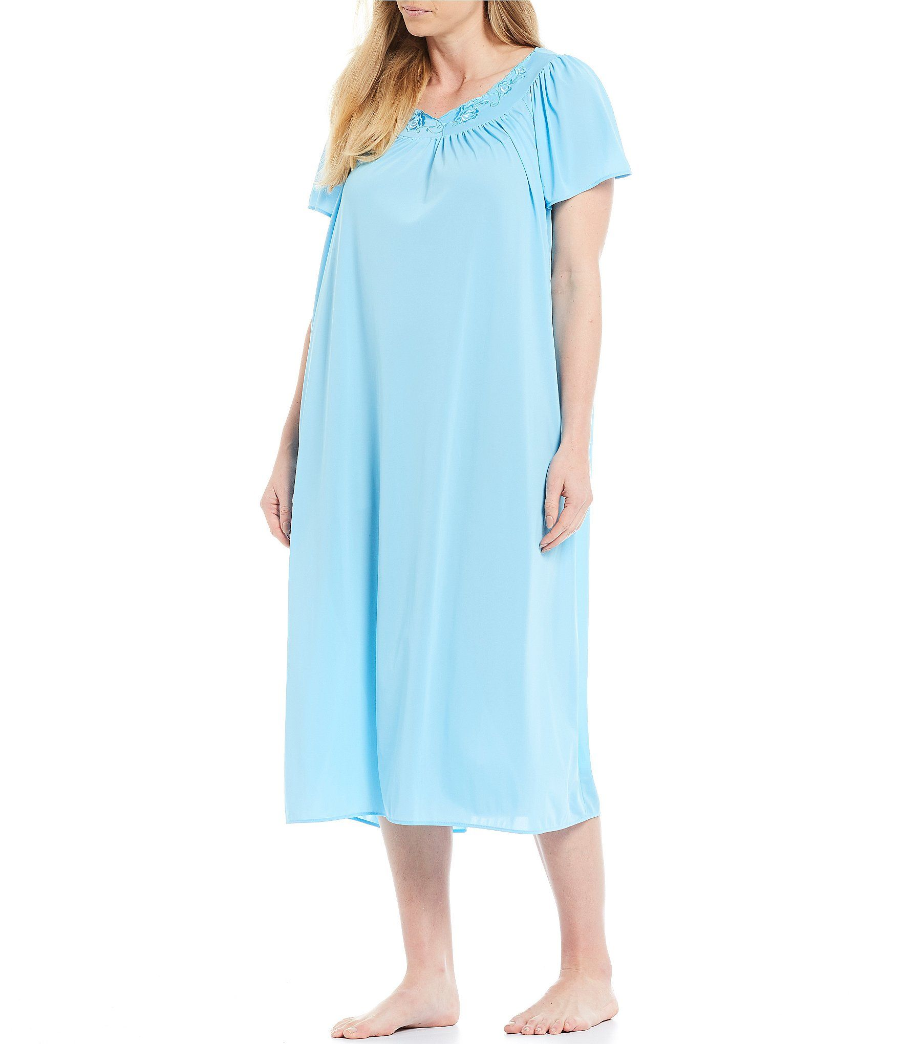 Softly fall asleep in this long Miss Elaine Plus gown. The scoop neckline, short sleeves and gentle gathers in the front and back make this design perfectly cozy.pretty floral embroidery at the necknylon knitmachine washableImported.