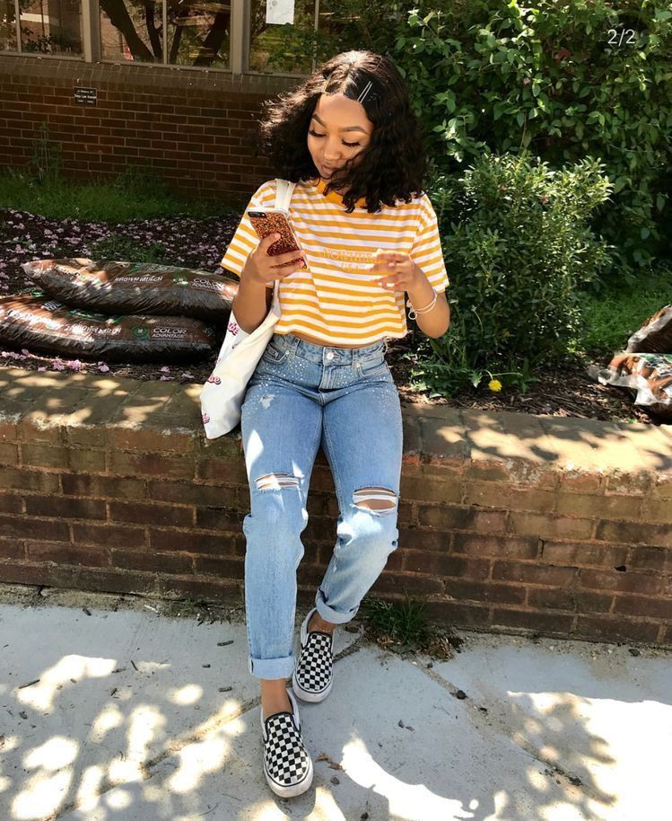 Very cute yellow striped crop top, ripped jeans, with