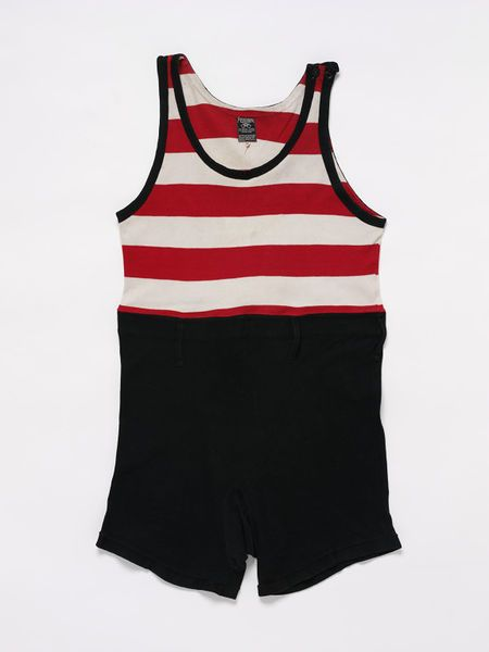 2ca6215121 1925 Man's bathing suit in wool jersey. In one-piece consisting of a  singlet top in broad red and white stripes and shorts in black, and with  belt loops ...