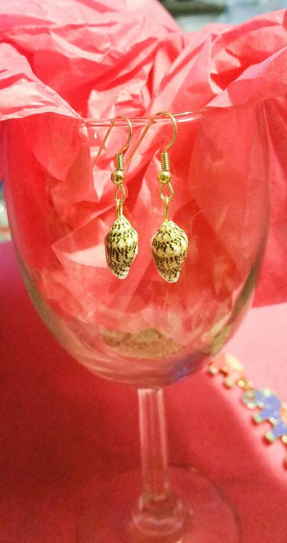 Check out this item in my Etsy shop https://www.etsy.com/listing/265229641/sea-shell-dangle-earrings