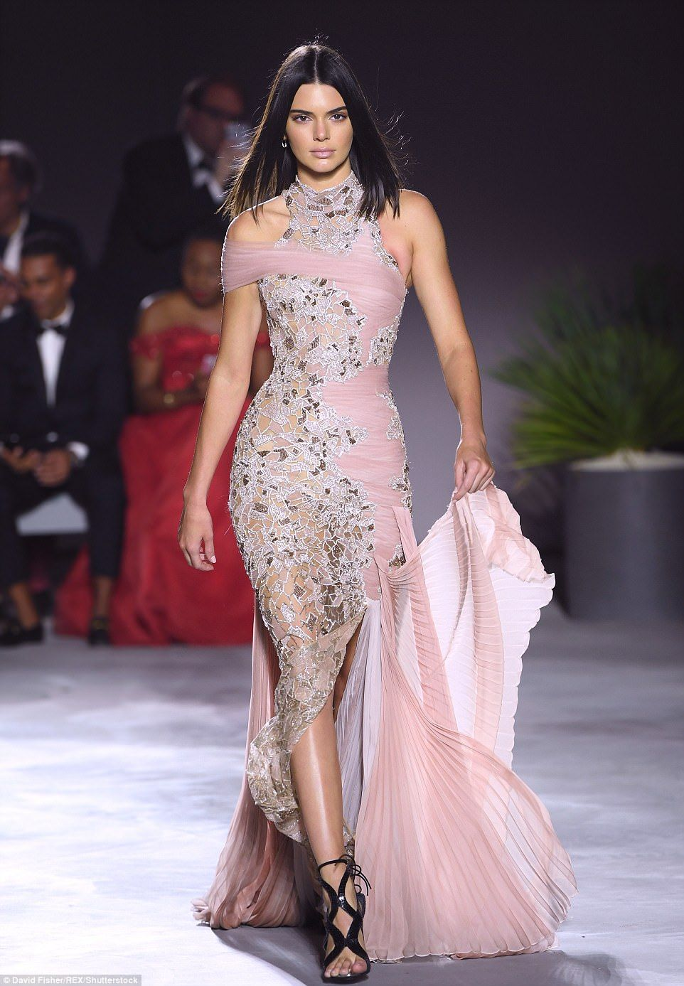 And another one! Kendall held up the train of this nude number with one hand as she strutted in front of the cameras