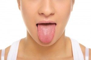 Tongue Scraping: The Many Benefits of an Ancient Practice