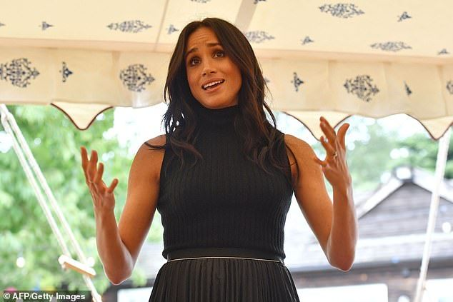 Meghan hails London's diversity at the launch of charity cookbook | Daily Mail Online