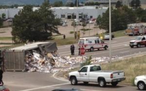 Semi-Truck dumped haul of trash after serious crash involving a sedan.
