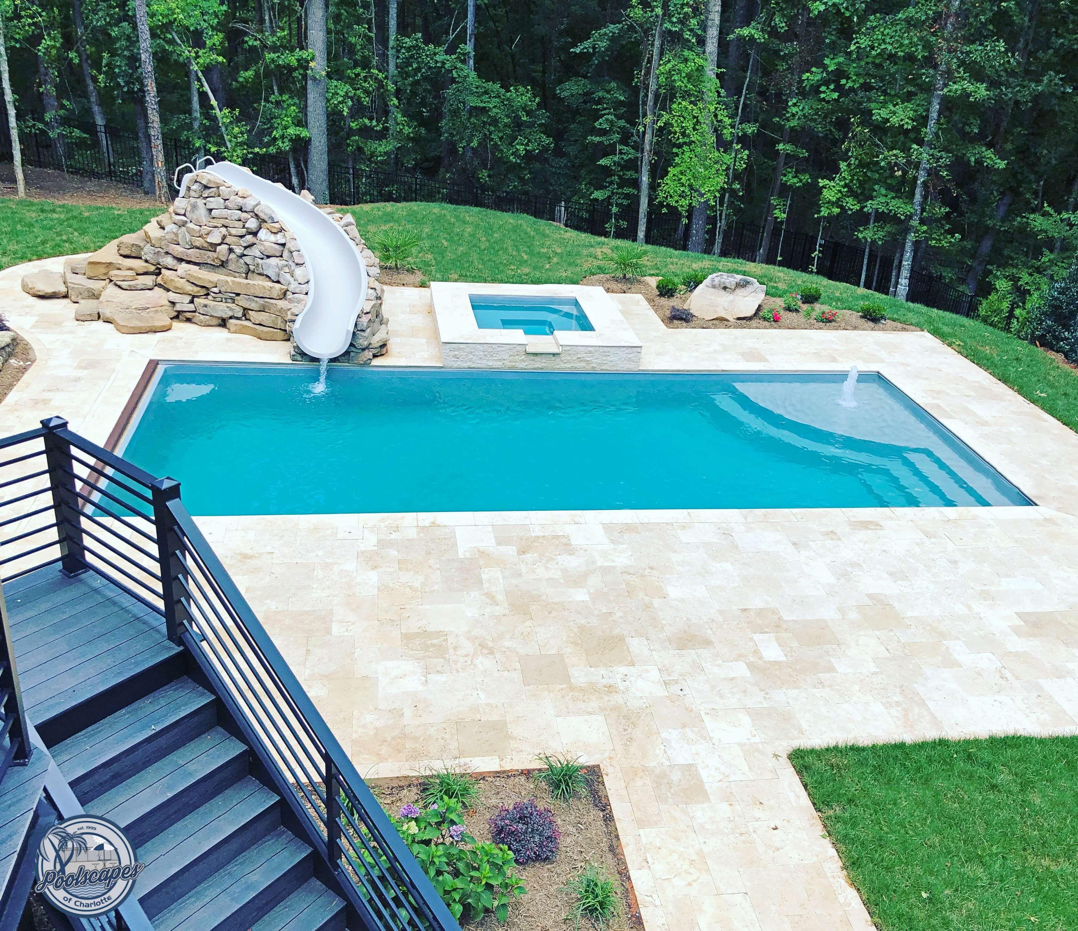 The Great Lakes In Your Backyard Pools Backyard Inground Travertine Pool Swimming Pools Backyard