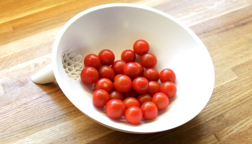 funnelled anton strainer bowl by caveman factory makes it easy to clean produce