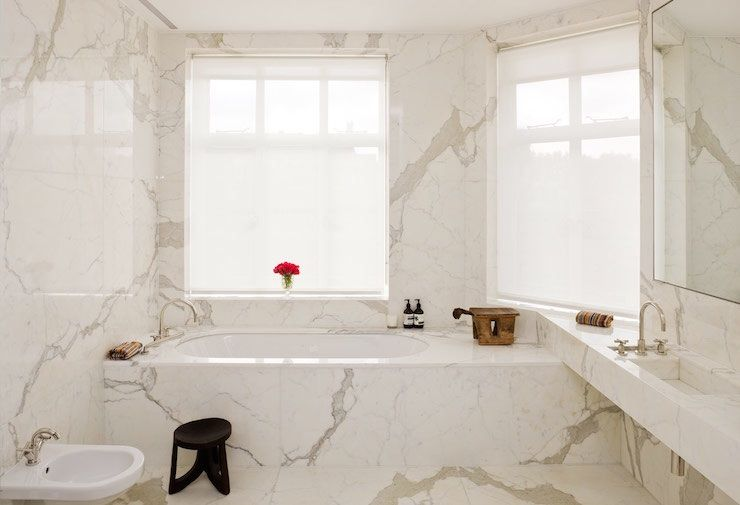 This Gorgeous Bathroom Has Calacatta Oro Marble Walls And
