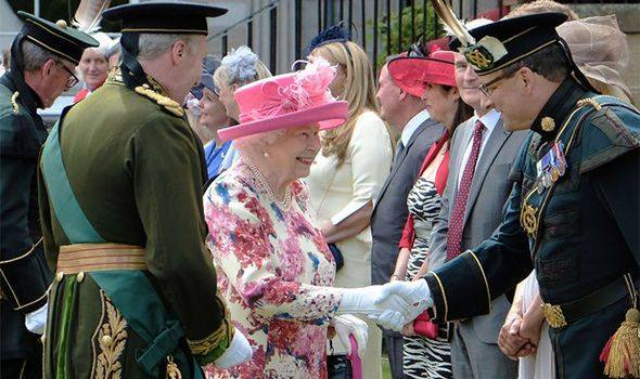 Radiant in pink! Queen hosts garden party at Holyrood Palace just days after falling ill is part of British garden Party - THE Queen was out and about again as she hosts a garden party at Holyrood Palace as part of weeklong stay in the Scottish capital, Edinburgh
