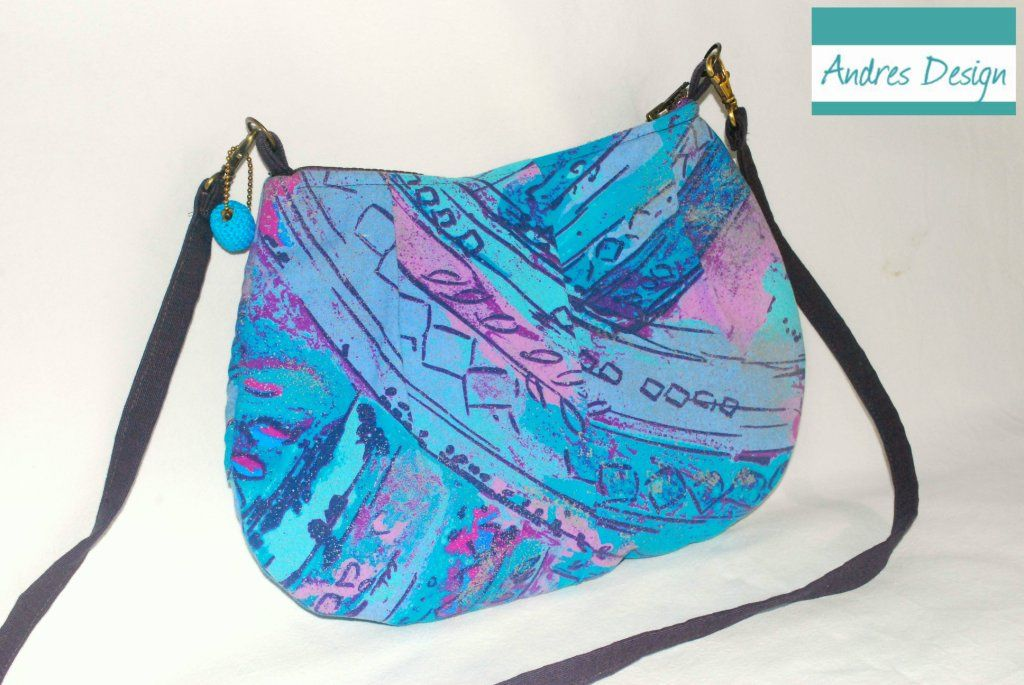 Small messenger bag with turquoise and purple print