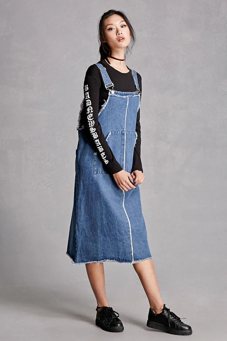 A pair of denim overalls featuring a square neckline, palazzo pants, slanted pockets, frayed trim, a deep square back, and a partially elasticized waist. This is an independent brand and not a Forever 21 branded item.