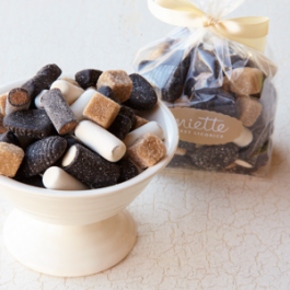 Sweet Dutch Licorice - We import our mixture of sweet licorice from Holland. Each piece offers a unique licorice flavor and texture. In the bag, you'll find brown licorice cubes with a soft, chewy texture. The Schoolkrijt are named after the school chalk they resemble - a crispy, minty shell covering chewy licorice inside. The Honey Tops are firm and soothing to the throat.