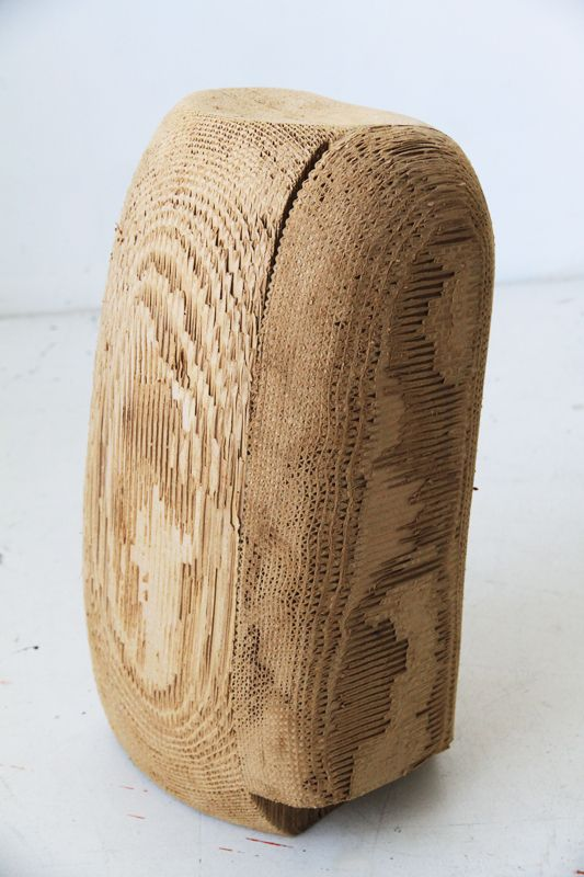"""""""Davis Sleeth's cardboard sculptures glued and sanded look just like drift wood logs, aged and eroded by tide and time"""""""