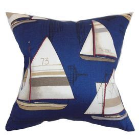 Cotton accent pillow with sailboats against a navy blue background. Made in the USA.  Product: PillowConstruction Material: Cotton cover and down fillColor: Navy blueFeatures:  Insert includedHidden zipper closureMade in the USA Dimensions: 18 x 18Cleaning and Care: Spot clean