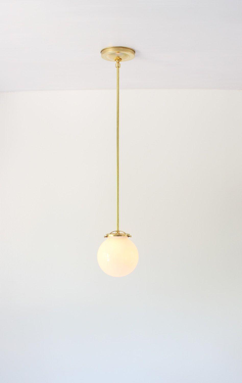 Modern brass pendant light white glass globe bootsngus interior