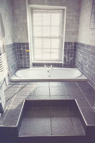 The Grey Stone Bathroom at Sedgeford Hall Norfolk Wedding and Event Venue - Holiday Cottages