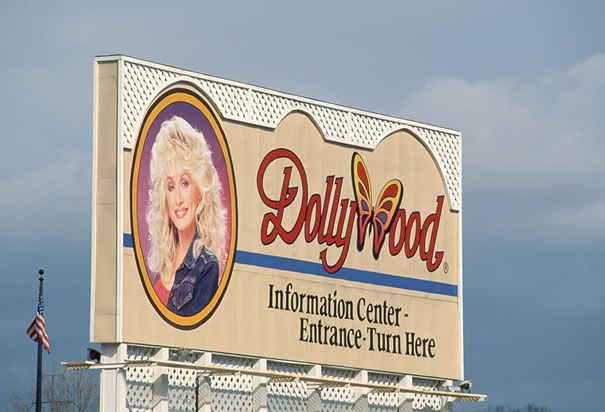 Dollywood A Billboard Directs Tourists To The Information Center At Dollywood An Amusement Park Built By Country Mu Tennessee Dollywood Great Smoky Mountains