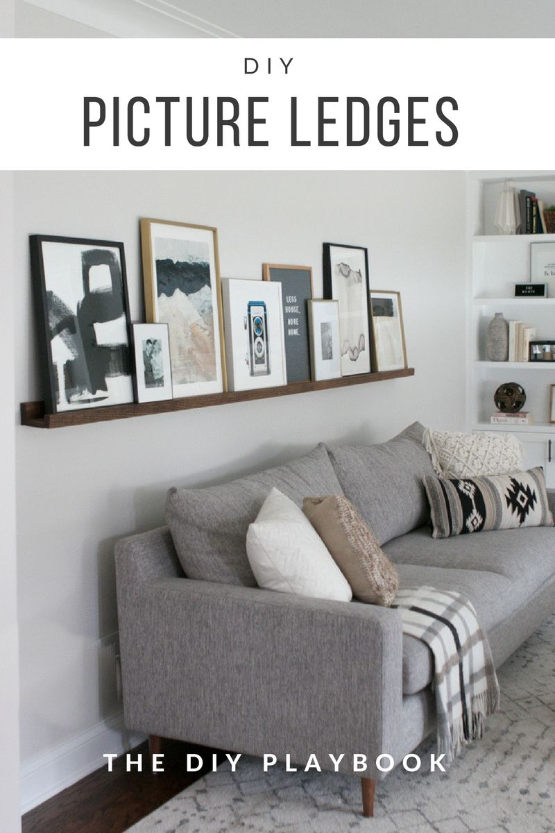 Diy Picture Ledge Over The Couch Filled With Art The Diy Playbook Couch Decor Living Room Diy Living Room Pictures