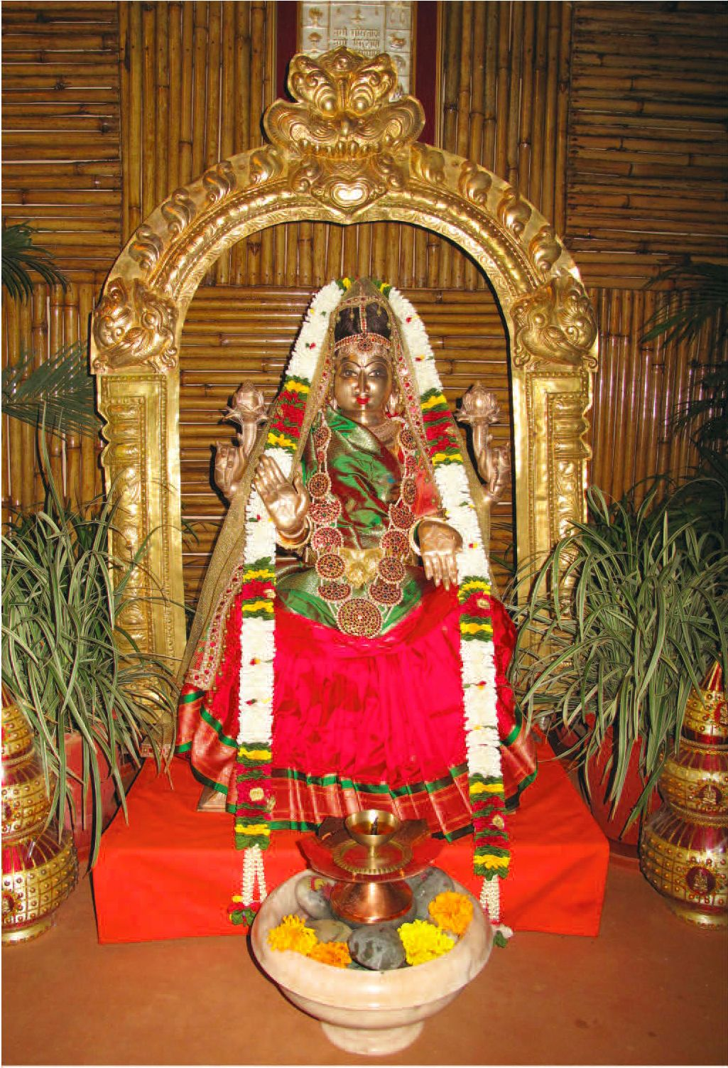 Lakshmi puja is conducted for general public welfare garlands of lakshmi puja is conducted for general public welfare garlands of jasmine flowers golden colored cloth betel and nuts kumkuma and lotus flowers are mightylinksfo