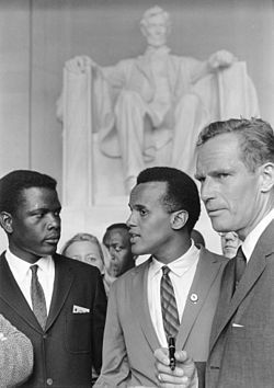 Belafonte (center) at the 1963 Civil Rights March on Washington, D.C with Sidney Poitier (left) and Charlton Heston.