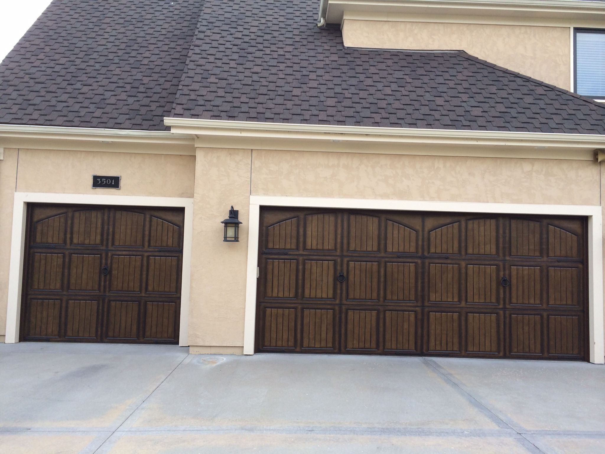 Triple Garage Door With Decorative Hinges Coastal Bronze 20 115