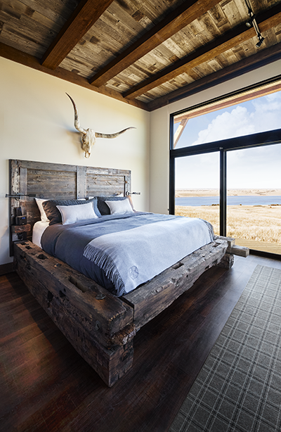 Rustic king bed frame, barn wood head board, antlers, sliding glass ...