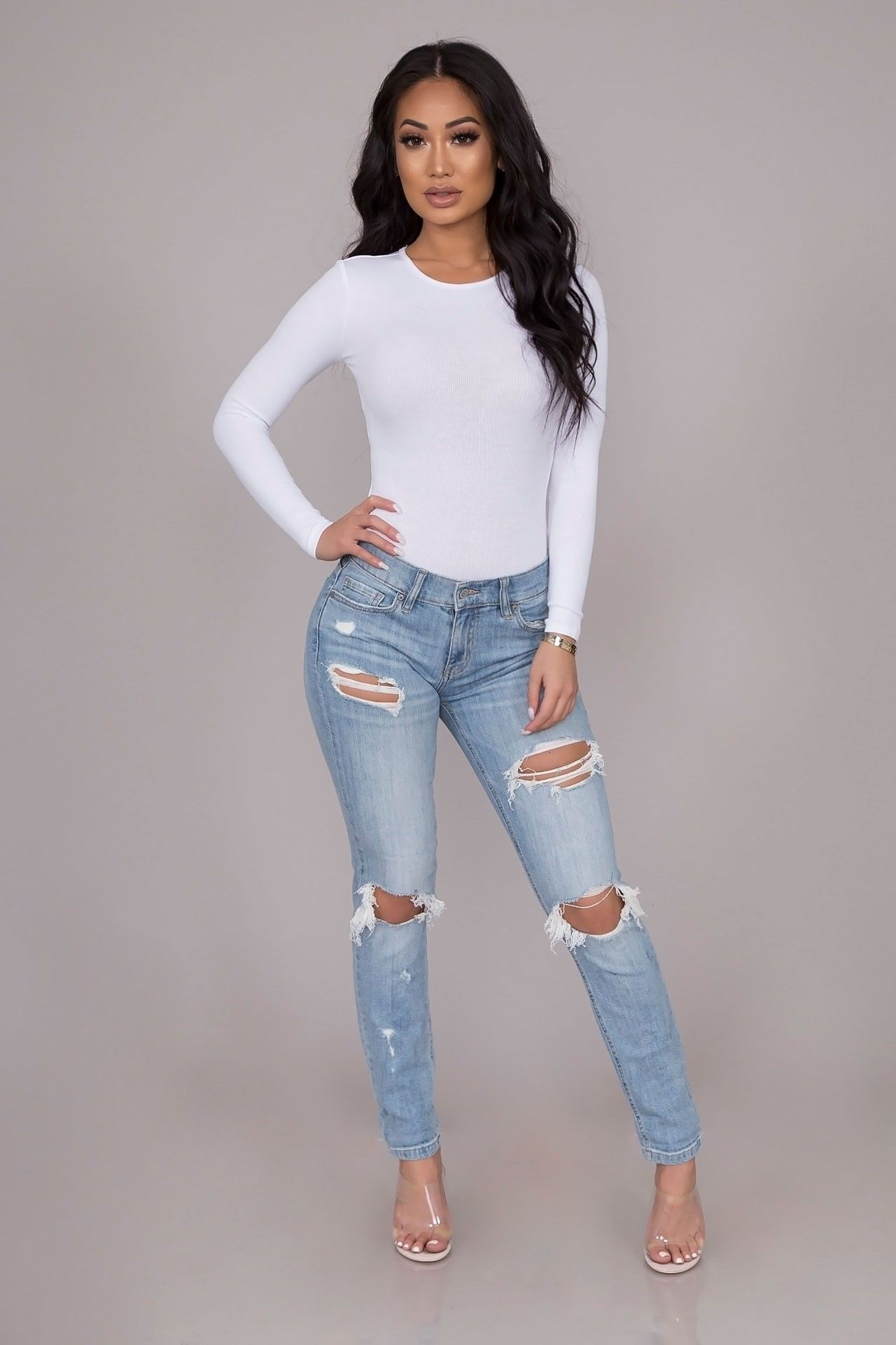 f666f5c462 A pair of easygoing skinny jeans jeans fashioned from a light-wash denim  woven with a comfortable stretch. It features a low-rise, distressed  accents, ...