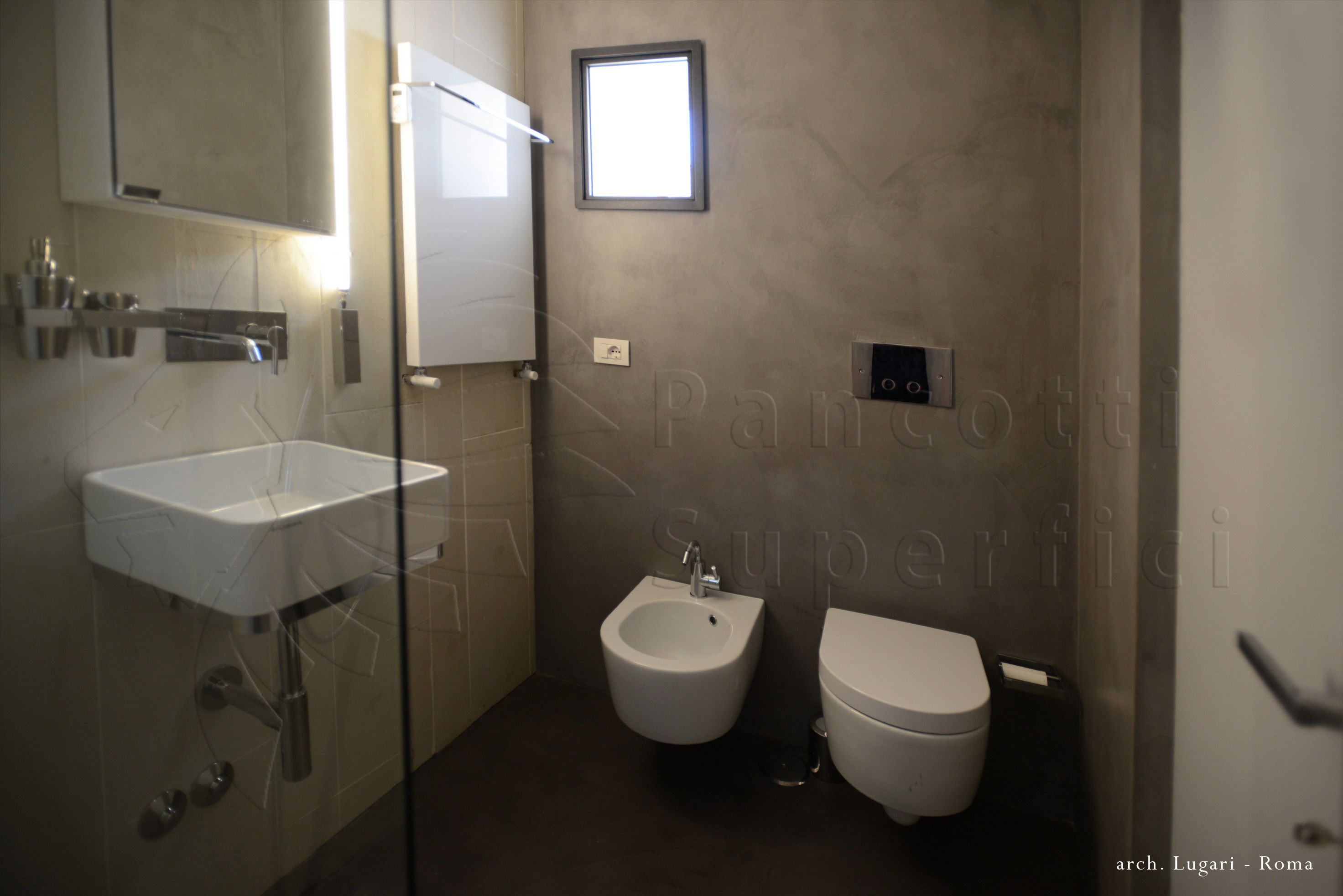 Rivestimento bagno microcemento colore tortora casa privata roma