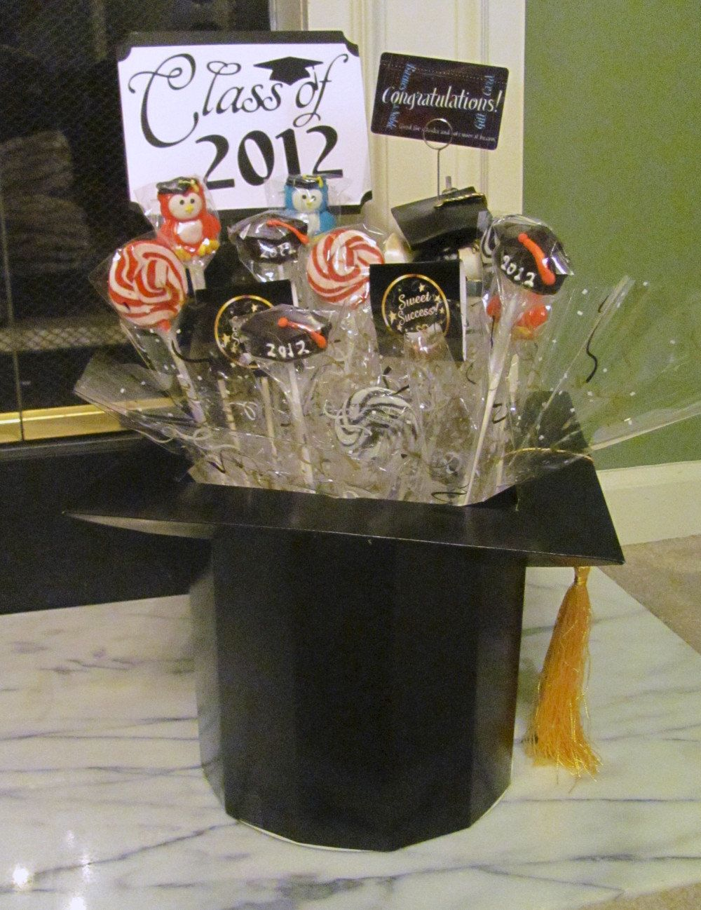 Graduation candy centerpiece featuring mortar board box