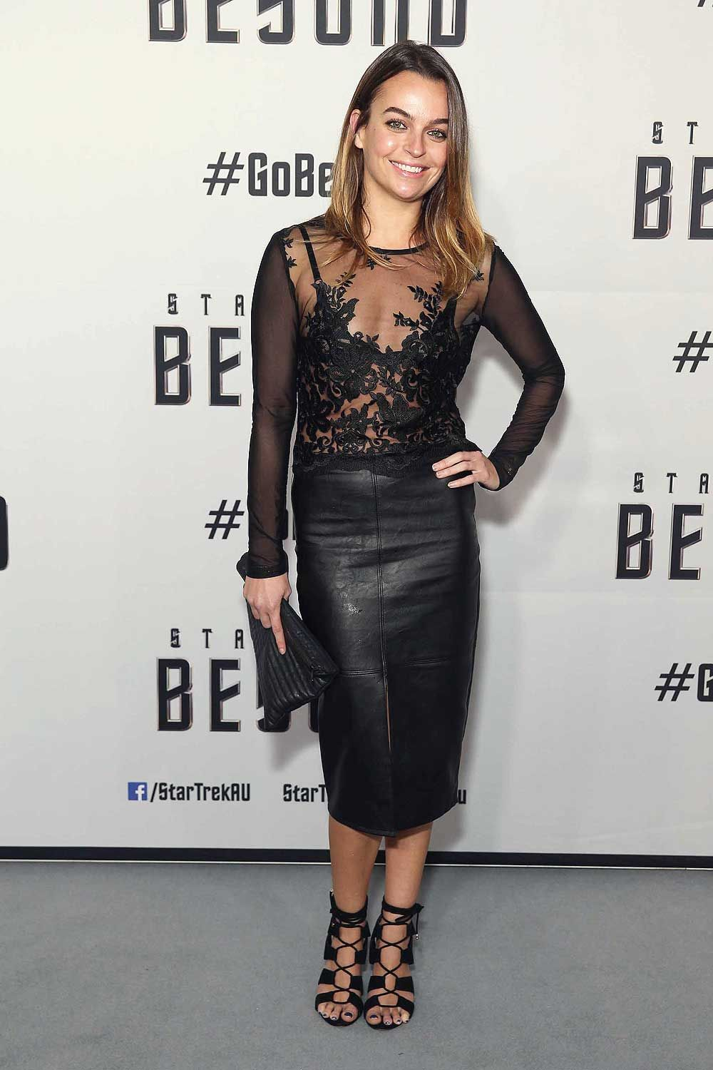 Bianca Brady wearing leather pencil skirt, leather skirt.