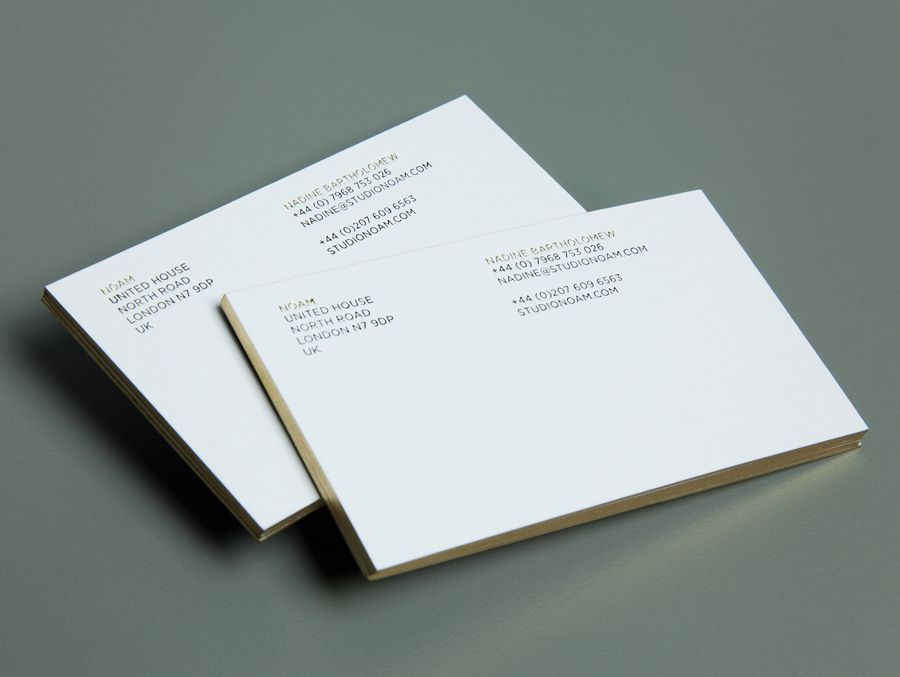 Business cards with gold detailing created by Graphical House for interior design consultancy Noam