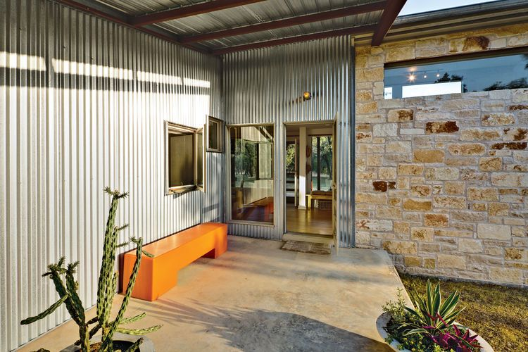 Front door entrance with orange bench and concrete flooring HOUSE