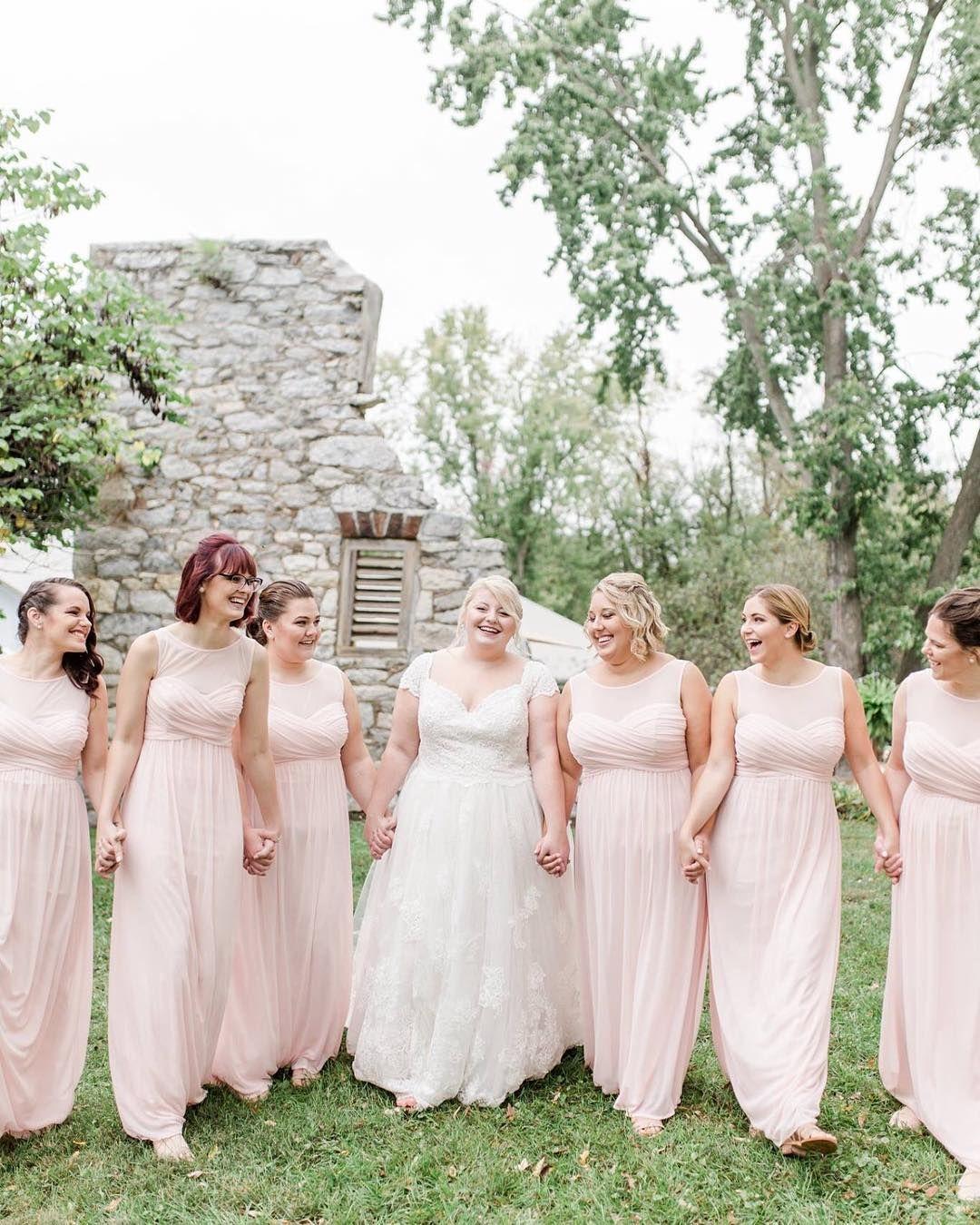 616328f29b David s Bridal bridesmaids in illusion neck long bridesmaid dresses in  pastel pink. See style F15927 in Petal from David s Bridal