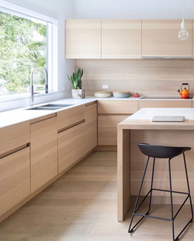 Minimalist Unite. Kitchen With Light Wood Cabinets And