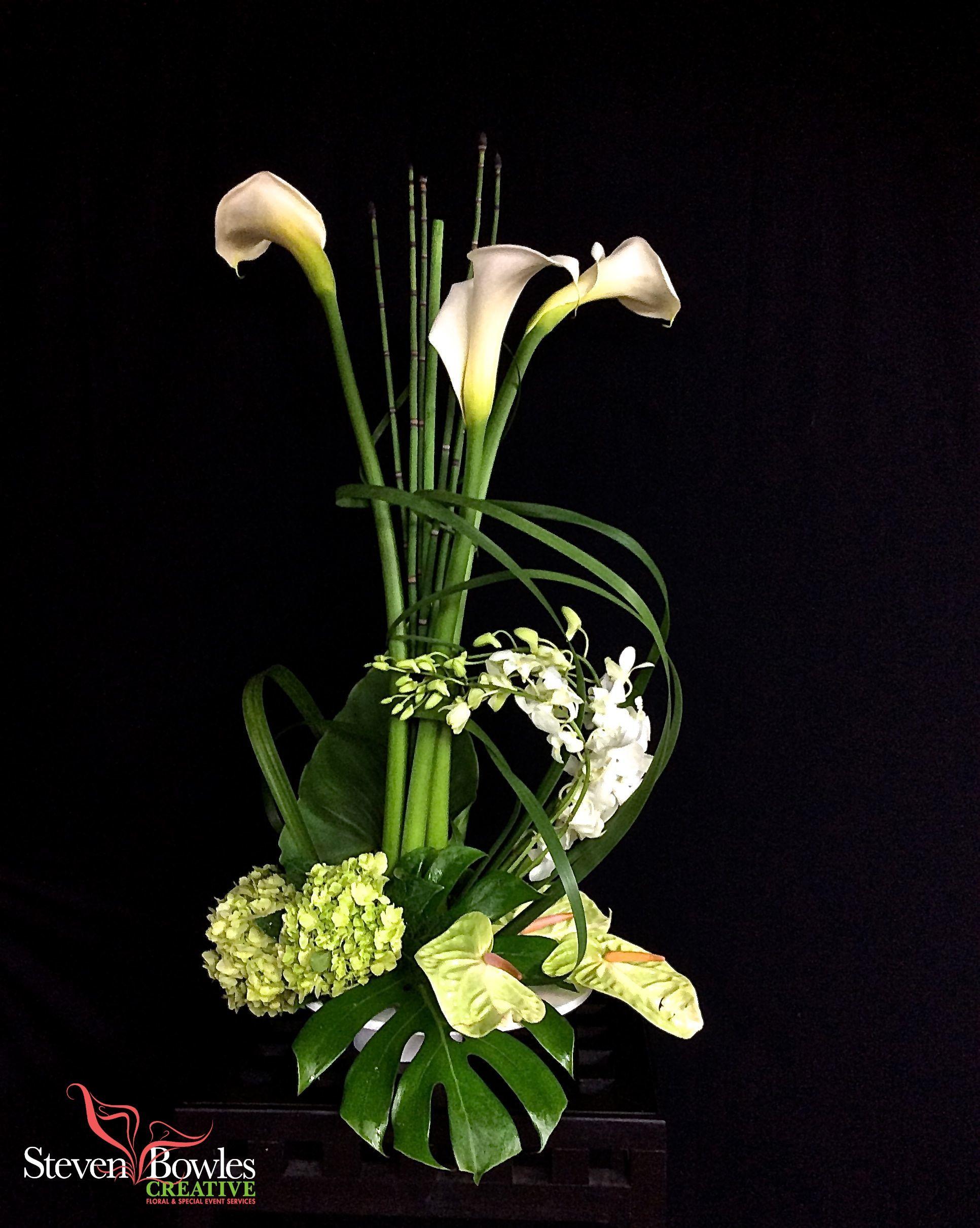 Modern flower arrangementcalla lily wedding table centerpiece modern flower arrangementcalla lily wedding table centerpiececontemporary calla lily arrangement of white dhlflorist Images