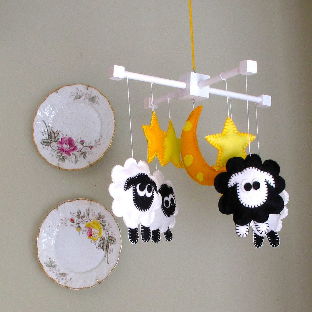 Just too cute!  Baby Nursery Mobile-Infant Crib Mobile - Counting Sheep - Black And White. $88.00, via Etsy.