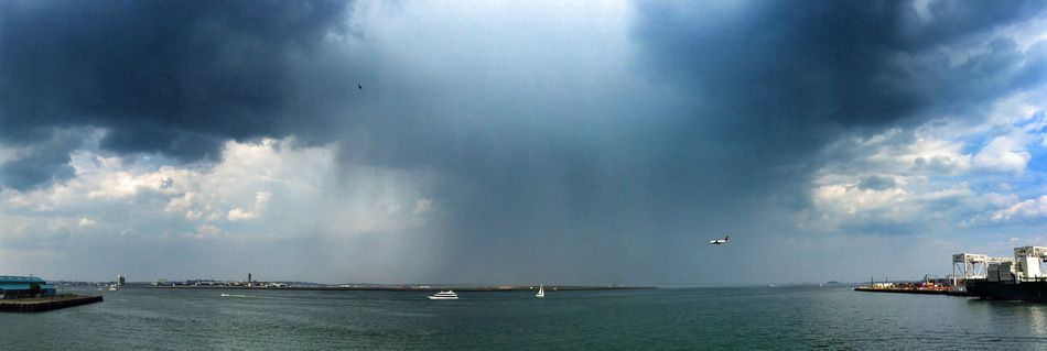 cloudburst at Logan airport (thunderstorm clouds boats water ). Photo by weatherpope