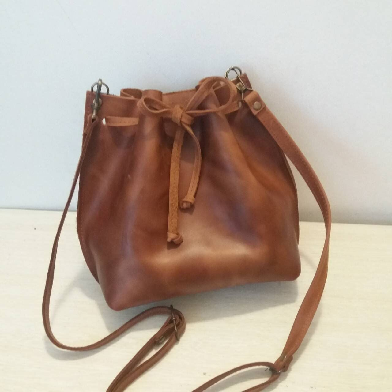 8bb465cb41 Excited to share the latest addition to my  etsy shop  Leather Bucket Bag  Leather Bucket Drawstring Bag Brown Leather Crossbody Bag Women Handmade  Cognac ...