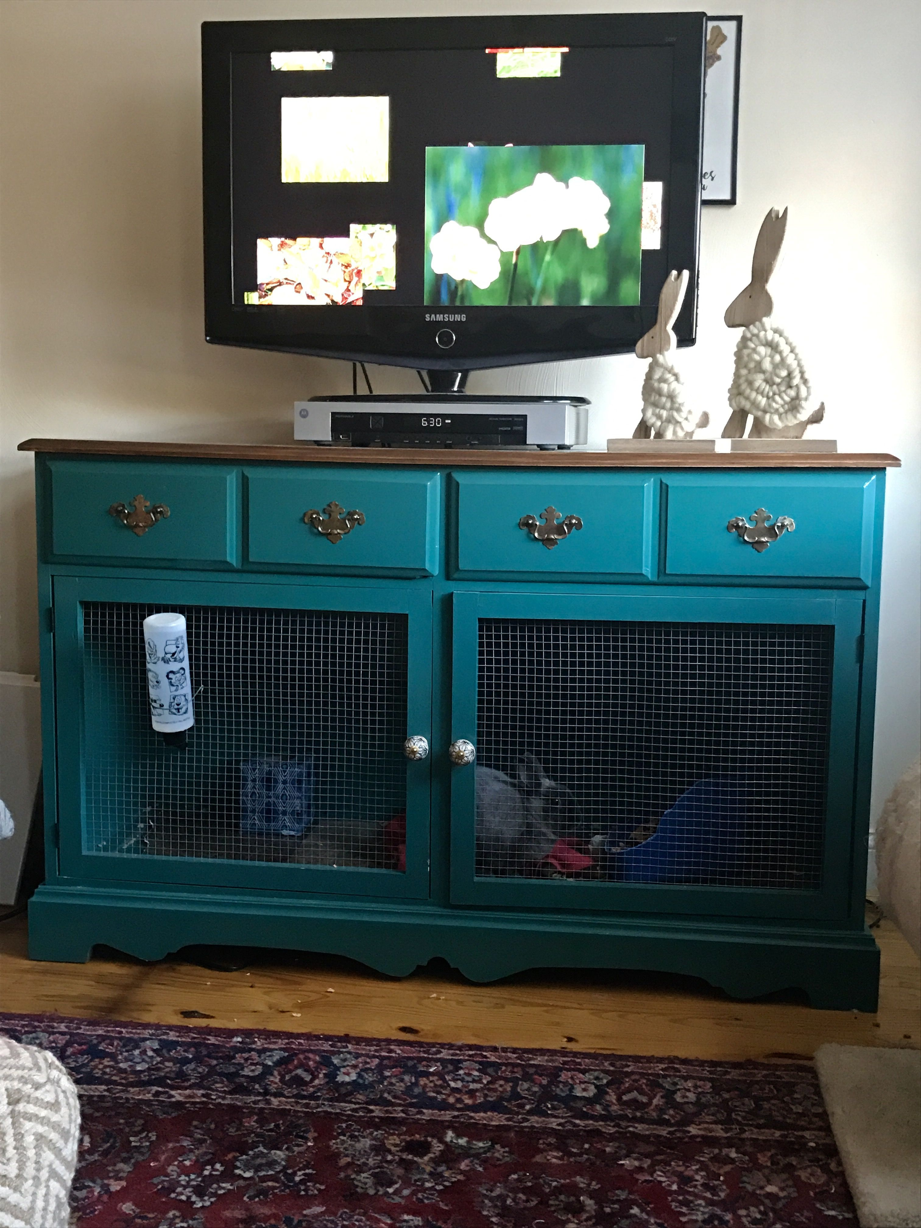 Refurbished an old dresser to become a bunny cage. Took out bottom ...