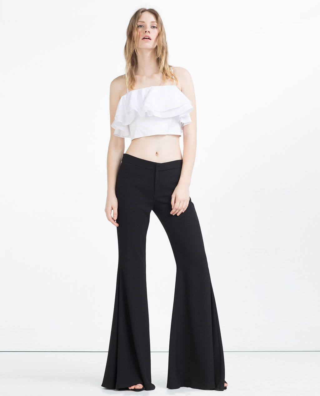ZARA - WOMAN - EXTRA FLARED TROUSERS. These remind me of Selena Quintanilla- WANT!