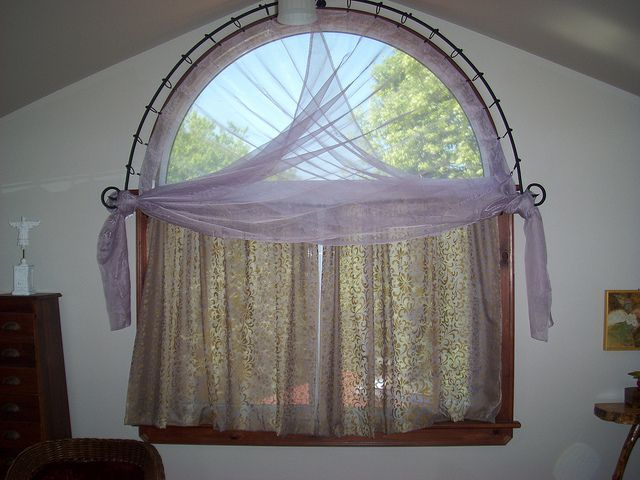 Half Moon Window With Custom Made Wrought Iron Curtain Rod Half