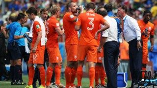 The Netherlands players take on fluids during a cooling break