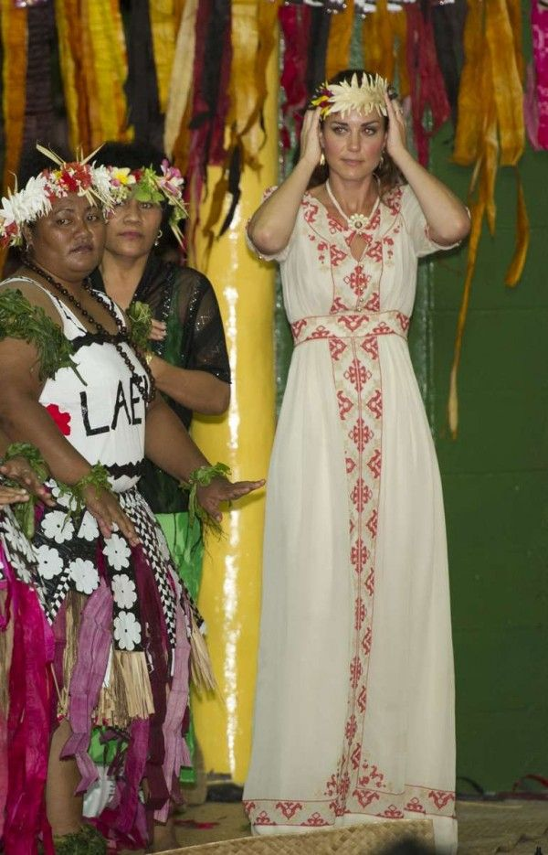 September 18, 2012: Kate Middleton learns how to dance with the locals in Tuvalu. She's wearing an embroidered Alice by Temperley Beatrice crepe maxi dress which was later accessorized with many grass skirts.