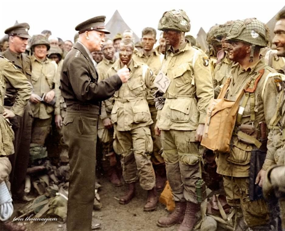 General Dwight D. Eisenhower meeting with men from Co. E, 2nd Battalion, 502nd Parachute Infantry Regiment (Strike) 101st Airborne Division, just before they load up for the drop on Normandy, June 5, 1944. The majority of the men in this photo were killed or wounded in battle a few hours later.