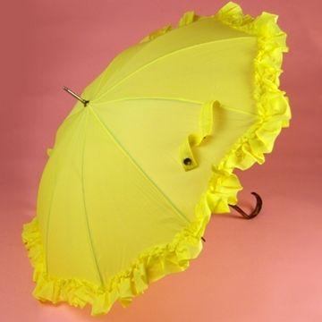 ce90ddf4b6b7d Bright yellow umbrella with large matching ruffle. Dark wooden hook handle.