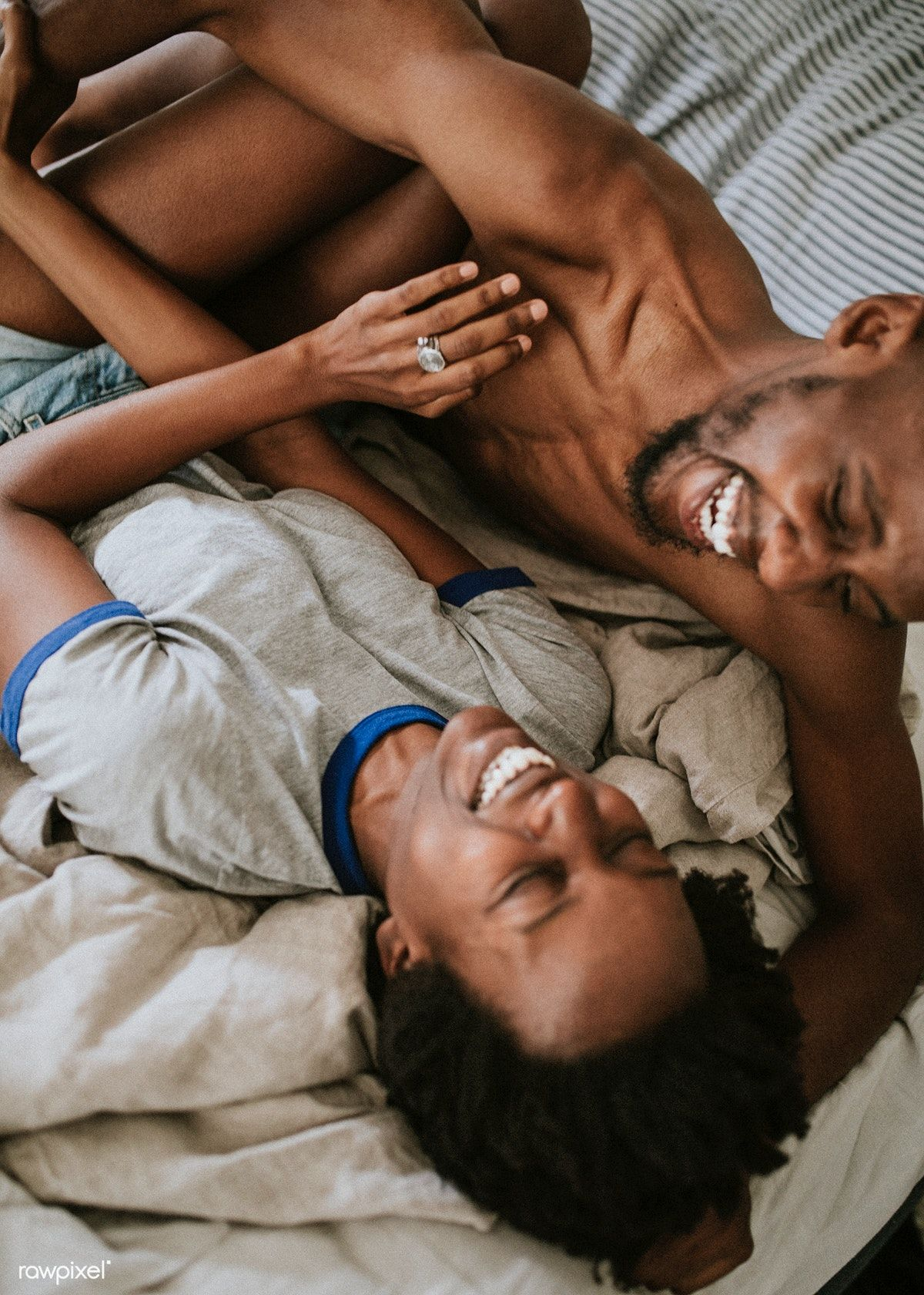Download premium photo of Cute happy black couple playing in bed 1211587
