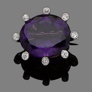 An amethyst and diamond brooch, circa 1890 The oval-cut amethyst highlighted with collet-set old brilliant-cut diamonds, diamonds approx. 0.30ct total, French assay mark, numbered, length 2.8cm