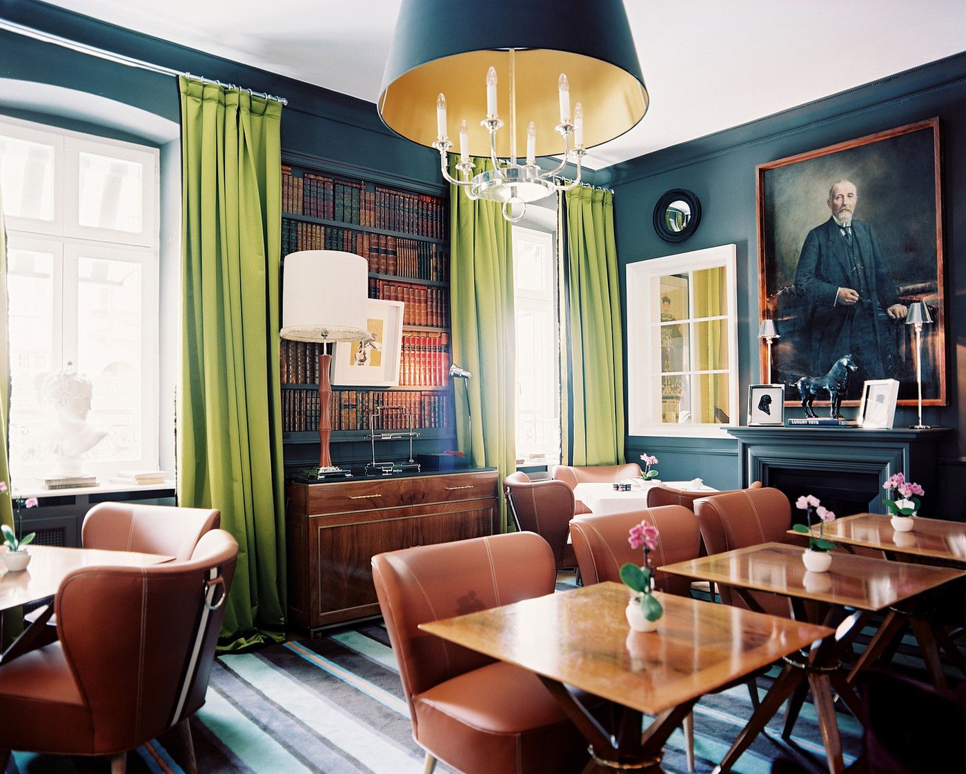 Leather chairs paired with square wooden dining tables