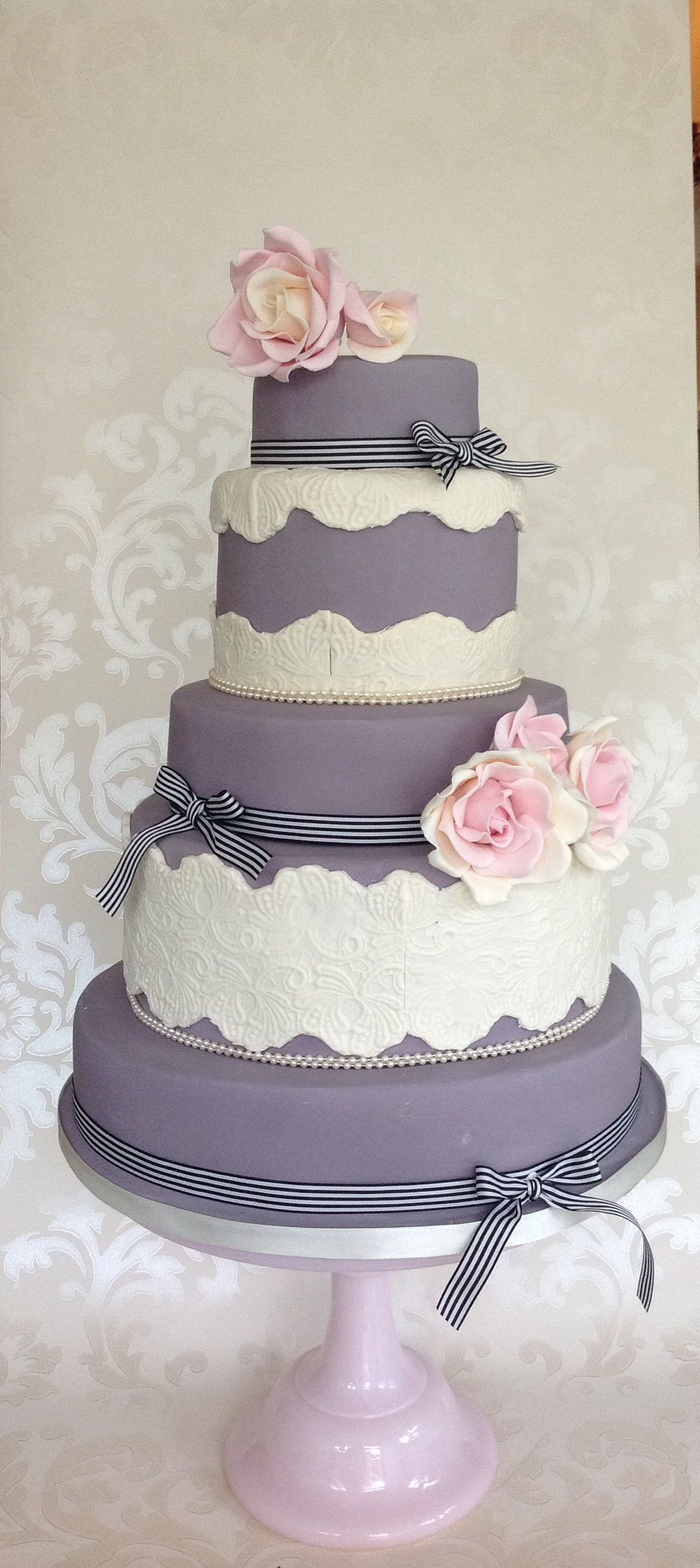 beautiful 5 tier wedding cake with lace and pearls. pastel pink